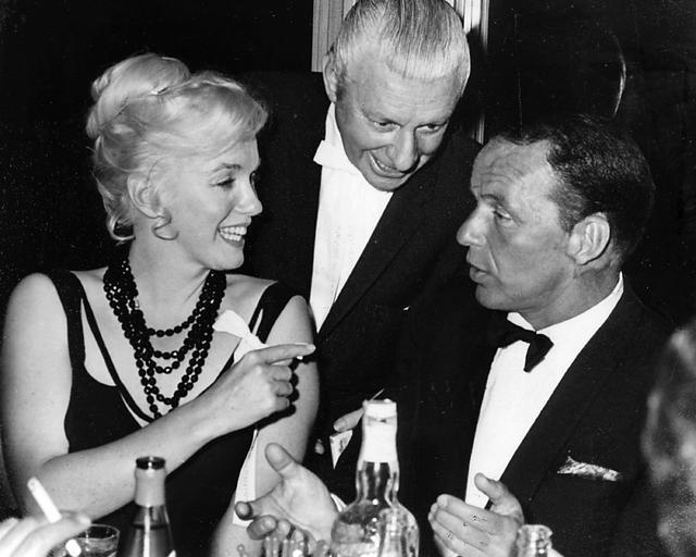 Marilyn Monroe talks with Frank Sinatra while an unidentified man looks on at the Cal Neva Lodge in Crystal Bay in 1959. The owner of the now-shuttered Cal Neva Lodge & Casino, once owned by F ...