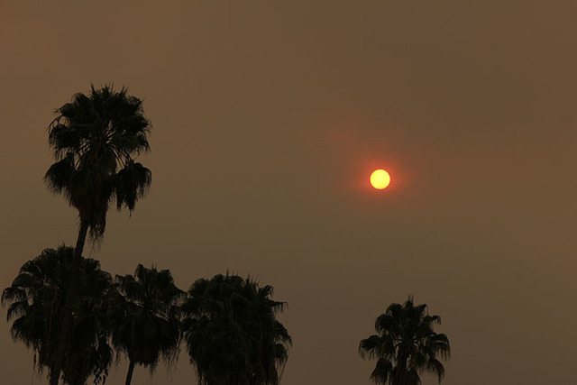 The morning sun over Pasadena, Calif., is reduced to an orange disk by smoke from a wildfire burning north of Los Angeles on Saturday, July 23, 2016. (John Antczak/The Associated Press)