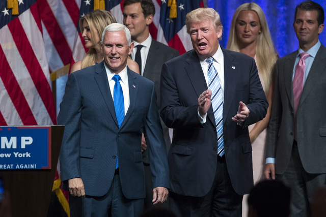 Donald Trump, right, introduces Gov. Mike Pence, R-Ind., during a campaign event to announce Pence as the vice presidential running mate on, Saturday, July 16, 2016, in New York. (Evan Vucci/The A ...