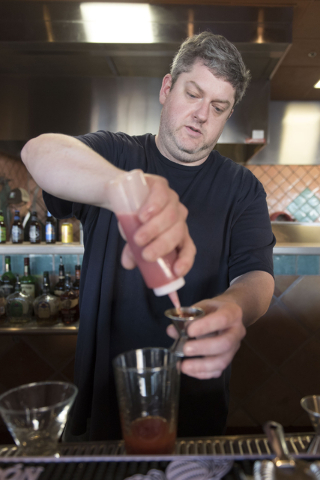 Carlito's Burritos/Live Fire Q, owner, Dave Samuels prepares a Red Chile strawberry spiked lemonade at his restaurant in Henderson Friday, July 15, 2016. Jason Ogulnik/Las Vegas Review-Journal