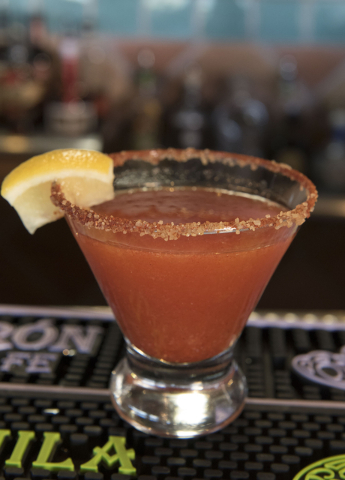 A Red Chile strawberry spiked lemonade sits on the bar at Carlito's Burritos/Live Fire Q in Henderson Friday, July 15, 2016. Jason Ogulnik/Las Vegas Review-Journal
