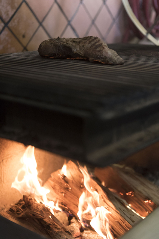 Tri-tip grills on a Santa Maria style barbecue grill pit at Carlito's Burritos/Live Fire Q in Henderson Friday, July 15, 2016. Jason Ogulnik/Las Vegas Review-Journal