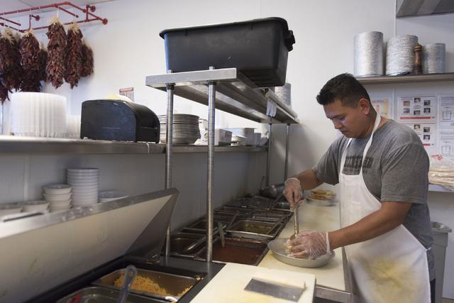 Lorenzo Rojas prepares a stuffed sopapilla at Carlito's Burritos/Live Fire Q in Henderson Friday, July 15, 2016. Jason Ogulnik/Las Vegas Review-Journal