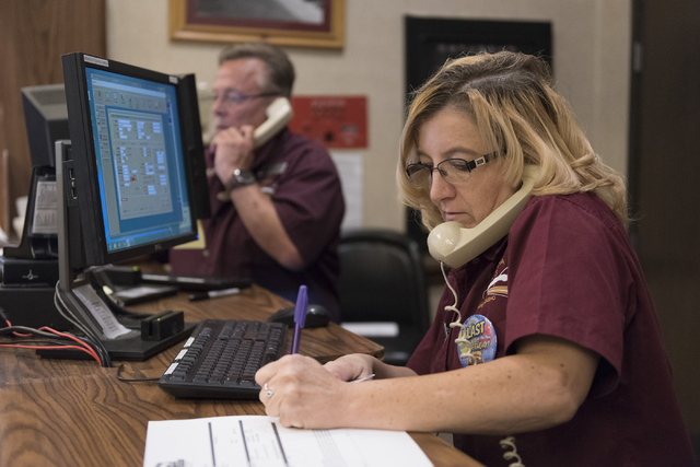 Patti Orton, right, and John McBroom answer phones from the reception desk at Railroad Pass hotel-casino in Henderson Friday, July 29, 2016. The hotel-casino celebrates its 85th anniversary this M ...