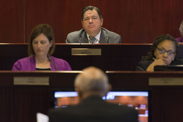State legislators Becky Harris, left, Michael Roberson, top, and Dina Neal, right, listen to education consultant Michael Strembitsky during a legislative committee meeting to discuss reorganizati ...
