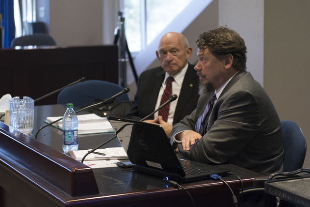 Clark County School District Superintendent Pat Skorkowsky, right, and education consultant Michael Strembitsky speak during a legislative committee meeting to discuss reorganization plans for the ...
