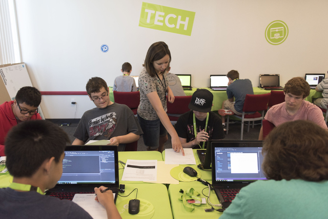 Instructor Hannah Nicholas, center, assists Java programming language students during the iD Tech camp at UNLV in Las Vegas Wednesday, June 29, 2016. The weeklong summer camp in technology is for  ...