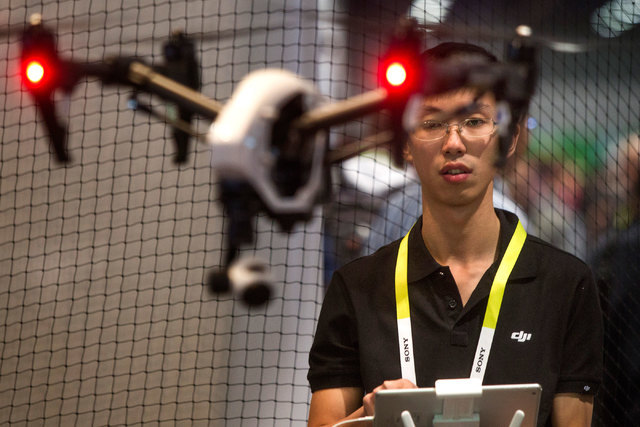 Yuxiang Deng with DJI Innovations operates an Inspire 1 drone Jan. 6, 2015, during the Consumer Electronics Show in the Las Vegas Convention Center. (Jeff Scheid/Las Vegas Review-Journal file)