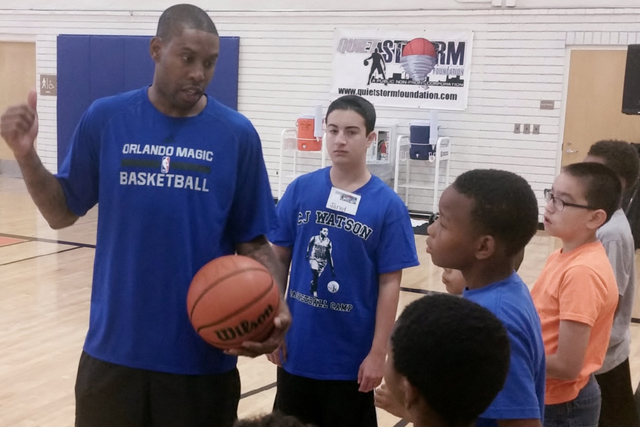 NBA veteran C.J. Watson, a former Bishop Gorman standout, gives pointers to local youth at his annual Hoops for Hope camp at Doolittle Community Center on July 16, 2016. (Ron Kantowski/Las Vegas R ...
