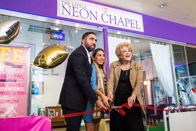 Minister Ben Silvano the owner of the Little Neon Chapel, left, Silvano's sister Sara El Hage, center, and the mayor of Las Vegas, Carolyn Goodman, center, cut the ribbon during the Chapel's grand ...