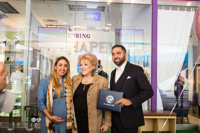 Minister Ben Silvano, owner of the Little Neon Chapel holds a certificate presented by the Mayor of Las Vegas, Carolyn Goodman, center, with his sister Sara El Hage, left, during the Chapel's gran ...