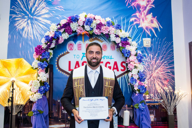 Minister Ben Silvano, owner of the Little Neon Chapel, holds a certificate presented by the mayor of Las Vegas, Carolyn Goodman during the Chapel's grand opening in the Neonpolis in Las Vegas Tues ...