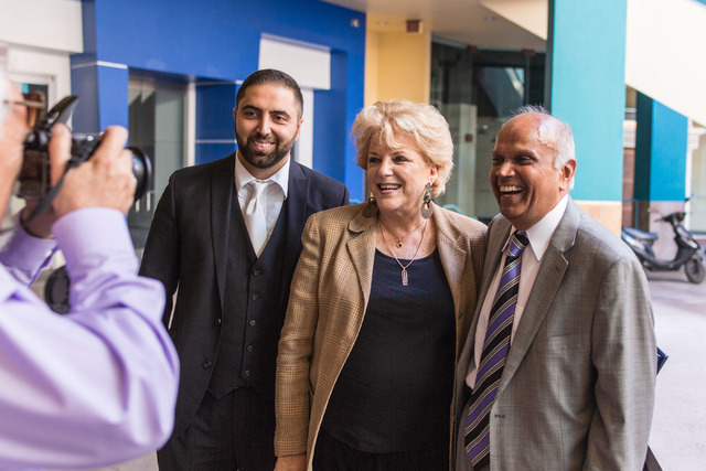 Minister and Little Neon Chapel owner Ben Silvano, left, poses for a photo with the Mayor Carolyn Goodman, center and Rohit Joshi during the Chapel's grand opening at Neonpolis in Las Vegas on Tue ...