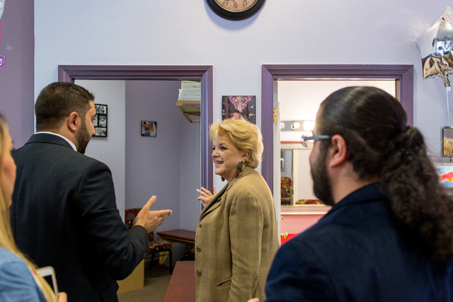 Minister Ben Silvano, the owner of the Little Neon Chapel, left, gives a tour to the mayor of Las Vegas, Carolyn Goodman, center, during the Chapel's grand opening in the Neonpolis in Las Vegas Tu ...