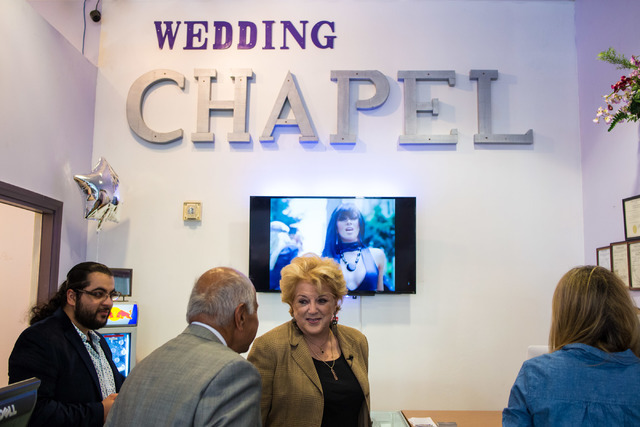 The mayor of Las Vegas, Carolyn Goodman, center, receives a tour of the Little Neon Chapel during the Chapel's grand opening in the Neonpolis in Las Vegas Tuesday morning, July 5, 2016. Elizabeth  ...