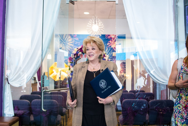 The Mayor of Las Vegas, Carolyn Goodman holds a certificate presented to the Little Neon Chapel during the Chapel's grand opening in the Neonpolis in Las Vegas Tuesday morning, July 5, 2016. Eliza ...