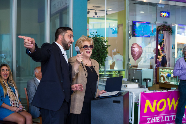 Minister Ben Silvano the owner of the Little Neon Chapel, left, speaks while receiving a certificate from the mayor of Las Vegas, Carolyn Goodman, center, during the Chapel's grand opening in the  ...