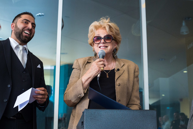 The mayor of Las Vegas, Carolyn Goodman, right, gives a certificate to Minister Ben Silvano the owner of the Little Neon Chapel, during the Chapel's grand opening in the Neonpolis in Las Vegas, Tu ...
