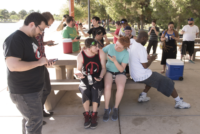 People gather in the shade to play Pokemon Go at Sunset Park in Las Vegas Sunday, July 10, 2016. (Jason Ogulnik/Las Vegas Review-Journal)