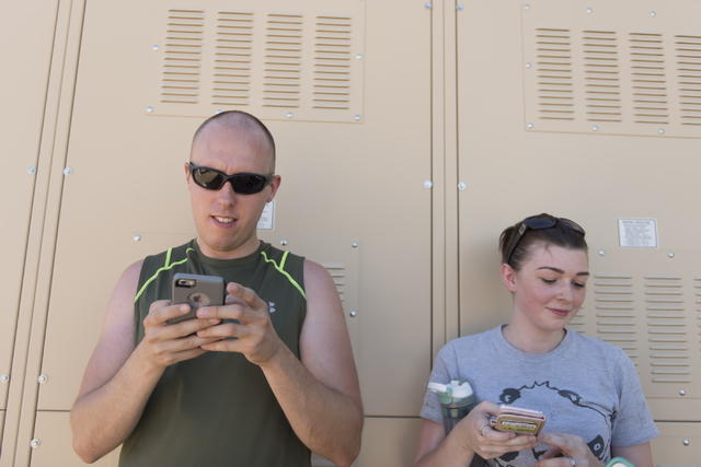 Jeremy and Leah Geoffrey play Pokemon Go at Sunset Park in Las Vegas as they speak with a reporter Sunday, July 10, 2016. (Jason Ogulnik/Las Vegas Review-Journal)