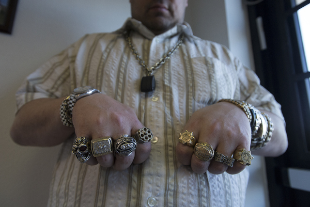 Owner of Nevada Coin Mart Neil Sackmary shows off his rings at his store in Las Vegas June 23. Bridget Bennett/View
