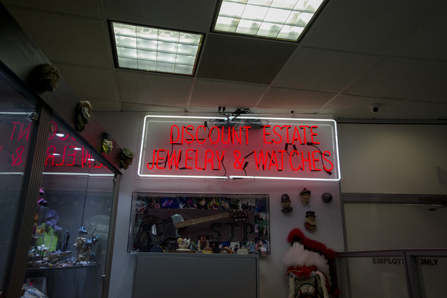A sign illuminates Neil Sackmary's store Nevada Coin Mart in Las Vegas on June 23. Bridget Bennett/View