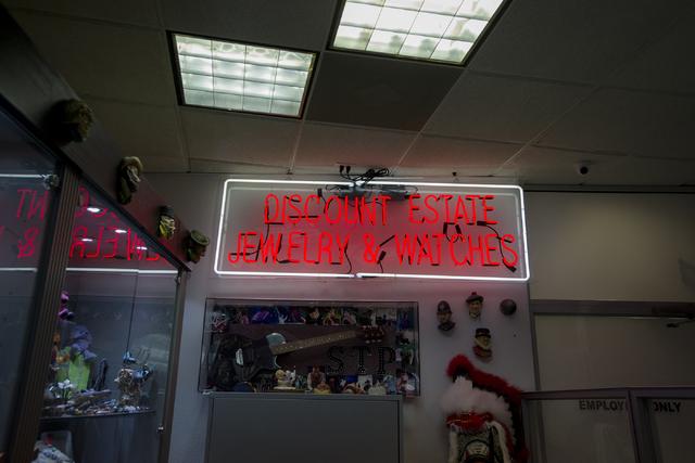 A sign illuminates Neil Sackmary's store Nevada Coin Mart in Las Vegas on June 23. Bridget Bennett/View