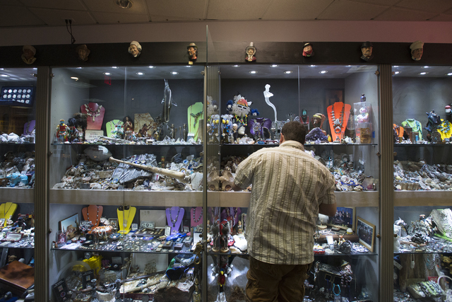 Owner of Nevada Coin Mart Neil Sackmary searches though his display case at his store at 4065 S. Jones Blvd. in Las Vegas June 23. Bridget Bennett/View  Follow @bridgetkbennett on Twitter