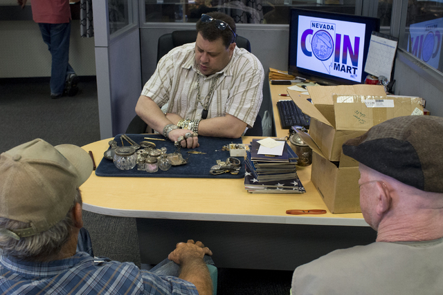 Owner of Nevada Coin Mart Neil Sackmary looks through customers' vintage goods June 28. Bridget Bennett/View