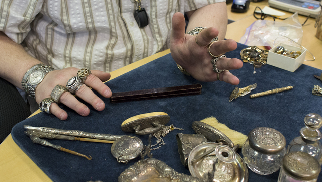 Owner of Nevada Coin Mart Neil Sackmary looks through customers' vintage goods June 28. Bridget Bennett/View