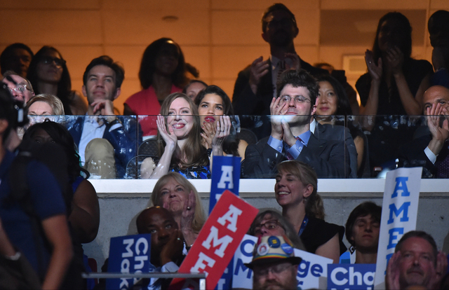 Chelsea Clinton listens as her father, former President Bill Clinton, as he addresses the Democratic National Convention in Philadelphia on Tuesday. Must credit: Washington Post photo by Jabin Bot ...