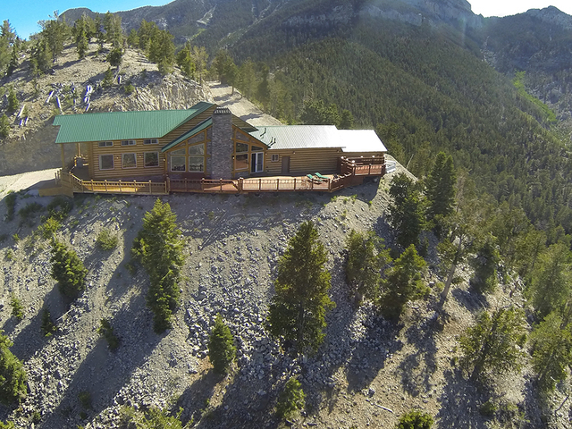 This cabin sits on the highest point of Mount Charleston. It and its 4.64 acres, which includes an adjacent lot for a helipad — is listed for $2.2 million. (Courtesy)