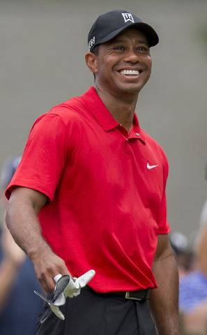 Tiger Woods smiles at the third tee during the final round of the Wyndham Championship golf tournament at Sedgefield Country Club in Greensboro, N.C., Sunday, Aug. 23, 2015. (AP Photo/Rob Brown)