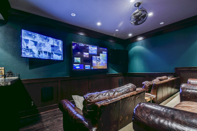The basement features a mega-entertainment area, with one room sectioned into a TV viewing area with comfortable leather seating. (The Napoli Group)