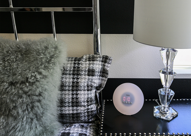 "Resident Jeramie Green rents a two-bedroom Elysian Well unit. He calls the built-in alarm clock ""pretty badass."" It gradually increases light in the room just before the alarm is set to go off, cr ..."
