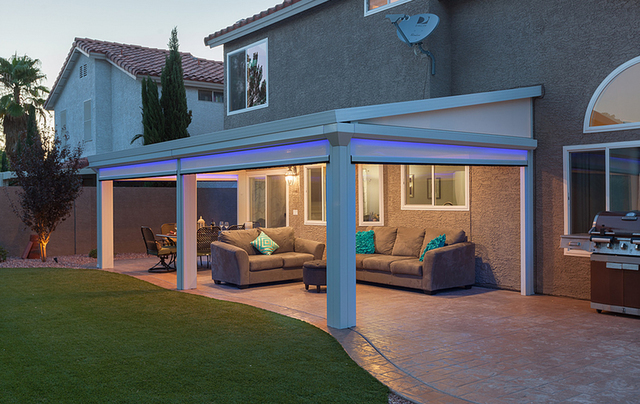 COURTESY DURA-KOOL Custom lighting packages, projection television and surround sound systems all add to the premium quality of the LifeRoom patio experience.