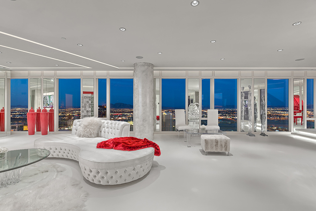 In the fully furnished main living room, bursts of the color red were incorporated in the design. (Courtesy of Luxury Estates International)