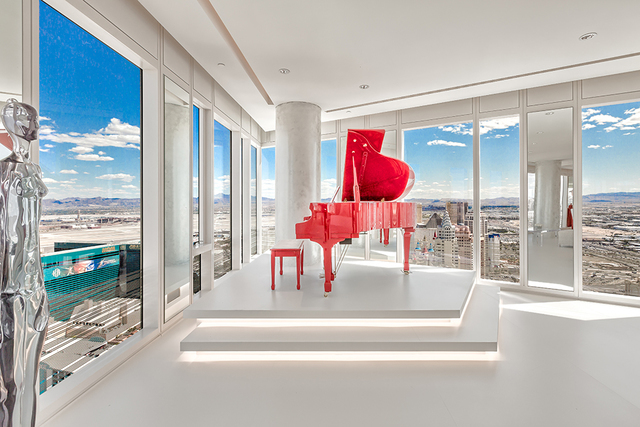 In the main living room is a bright red Pramberger Legacy Series player piano placed on a platform that can be controlled by iPad and provide choices of playing solo or accompanying programmed voc ...