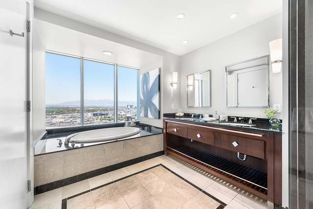 The remodeled Sky units have glass tile backsplashes, quartzite countertops and distressed hardwood flooring. (Courtesy of Luxury Real Estate Lounge)