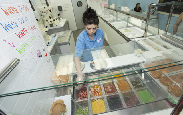 Miranda Werner, 21, adds toppings to an order of shaved snow at Yuki Shaved Snow located at 8414 Farm Road, Suite 150 in Las Vegas on Thursday, June 30, 2016. Richard Brian/Las Vegas Review-Journal