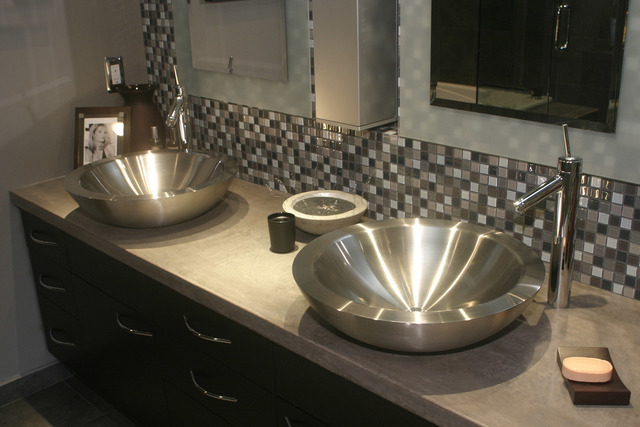 COURTESY CONCRETENETWORK.COM This bathroom counter was done by Tom Ralston Concrete, a third-generation concrete company of Santa Cruz, California.