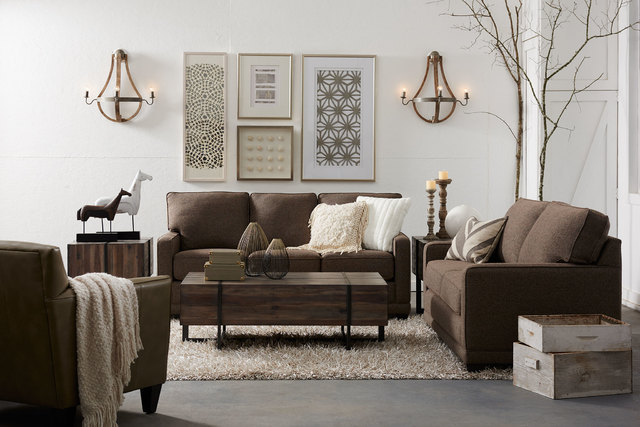 COURTESY LA-Z-BOY This thick shaggy area rug balances out the smooth leather of the brown chair.