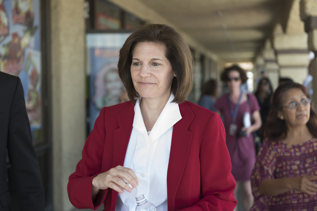 U.S. Senate Democratic candidate Catherine Cortez Masto walks to the East Las Vegas Community Center on Eastern Avenue in Las Vegas to cast her early vote in the state primary election Tuesday, Ma ...