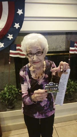 """Winifred """"Winnie"""" Garvin, a resident of Prestige Senior Living at Mira Loma in Henderson shows her Cracker Barrel Christmas ornament she purchased at an Indianapolis location. (Courtesy)"""