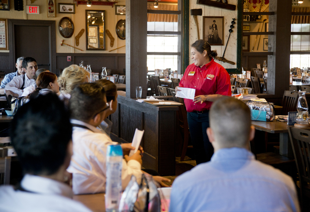 Erica Trujillo, right, trains staff at the new Cracker Barrel location near the Silverton hotel-casino in Las Vegas on Monday, July 18, 2016. The restaurant and store will have its grand opening M ...