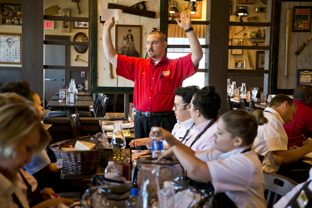 James Golden, center, trains staff at the new Cracker Barrel location near the Silverton hotel-casino in Las Vegas on Monday, July 18, 2016. The restaurant and store will have its grand opening Mo ...