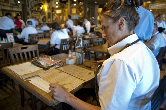 Tammi Ramirez, a server, studies the menu at the new Cracker Barrel location near the Silverton hotel-casino in Las Vegas on Monday, July 18, 2016. The restaurant and store will have its grand ope ...