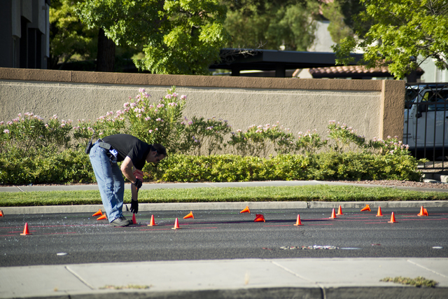 A Metro officer picks up cones at the scene of a suspected DUI crash on eastbound Charleston Avenue near Rampart Boulevard in Las Vegas on Friday, July 22, 2016. (Daniel Clark/Las Vegas Review-Jou ...