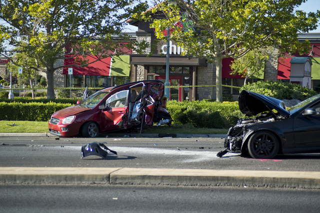 Two vehicles involved in a suspected DUI crash on eastbound Charleston Avenue near Rampart Boulevard remain on the road in Las Vegas on Friday, July 22, 2016. (Daniel Clark/Las Vegas Review-Journa ...