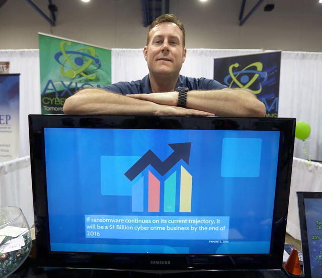 Axiom Cyber Solutions CEO Troy Wilkinson stands for a photo during the Business Expo sponsored by Las Vegas Metro Chamber at Cashman Field on Wednesday, June 15, 2016.  Jeff Scheid/Las Vegas Revie ...